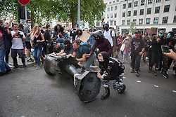 **Previously unseen pictures**<br /> © Licensed to London News Pictures; 07/06/2020; Bristol, UK. Protesters roll a statue of Edward Colston towards briton Docks after it was pulled down with a rope during a Black Lives Matter march through the city centre. The death of George Floyd, who died after being restrained by a police officer In Minneapolis, Minnesota, caused rioting and looting across the U.S.A and protests across the world. Photo credit: Mark Simmons/LNP.