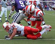 Louisville running back George Stripling (24) dives over teammate Brock Bolen (32) for a one-yard touchdown run in the third quarter against Kansas State, at Bill Snyder Family Stadium in Manhattan, Kansas, September 23, 2006.  The 8th ranked Louisville Cardinals beat K-State 24-6.