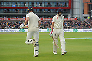 Wicket - Joe Root of England looks dejected as he walks back to the pavilion after being dismissed by Josh Hazlewood of Australia as Ben Stokes of England comes out to bat during the International Test Match 2019, fourth test, day three match between England and Australia at Old Trafford, Manchester, England on 6 September 2019.