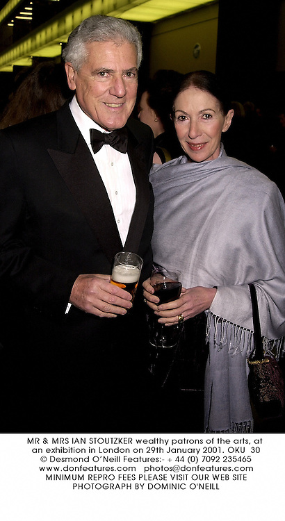 MR & MRS IAN STOUTZKER wealthy patrons of the arts, at an exhibition in London on 29th January 2001.	OKU  30