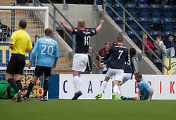 Falkirk's Rory Loy (hidden, right) scoring first goal.<br /> half time : Falkirk 1 v 0 Dundee, 21/9/2013.<br /> &copy;Michael Schofield.
