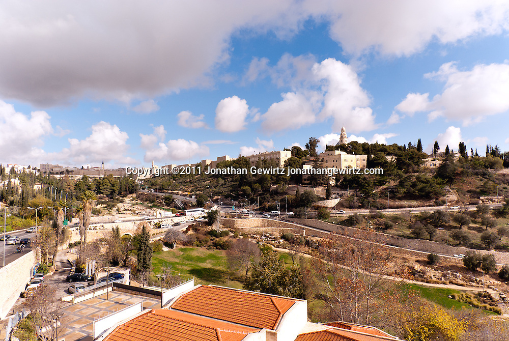 View from the Southwest of  Mount Zion, the Dormition Abbey and Jerusalem Old City walls. WATERMARKS WILL NOT APPEAR ON PRINTS OR LICENSED IMAGES.