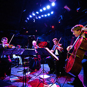 January 8, 2012 - Manhattan, NY : The Calder Quartet comprised of, from left, Benjamin Jacobson (violin), Andrew Bulbrook (violin), Jonathan Moerschel (viola), and Eric Byers (cello) perform with Andrew W.K. (not visible) at Le Poisson Rouge in Manhattan on Sunday evening.  CREDIT: Karsten Moran for The New York Times