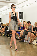 Halter-top ensemble in black and gray. By Carmen Marc Valvo at the Spring 2013 Fashion Week show in New York.