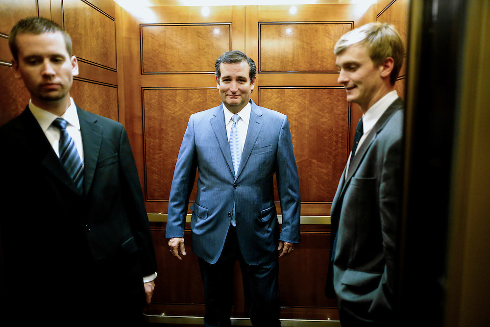 U.S. Senator Ted Cruz (R-TX) boards an elevator just off the Senate floor during furious deliberations over the looming government shutdown in 2013, a move Cruz championed as a way for Republicans to fight Obamacare just as it was to be implemented.
