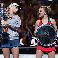 Caroline Wozniacki of Denmark and Simona Halep of Romania during the trophy presentation after winning the women's singles championship match during the 2018 Australian Open on day 13 in Melbourne, Australia on Saturday night January 27, 2018.<br /> (Ben Solomon/Tennis Australia)