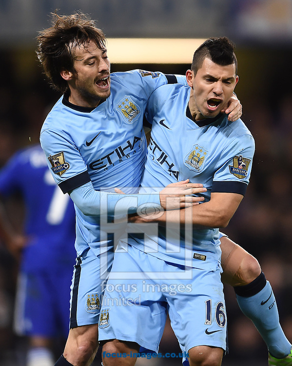 David Silva and Sergio Aguero of Manchester City celebrates scoring their first goal during the Barclays Premier League match against Chelsea at Stamford Bridge, London<br /> Picture by Andrew Timms/Focus Images Ltd +44 7917 236526<br /> 31/01/2015