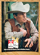 Photo of 1970s magazine advert for Marlboro cigarettes showing a cowboy smoking