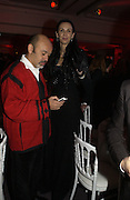 L'wren Scott and  Christian Louboutin. The Sidaction Party raising funds to treat AIDS, held during Haute Couture week  Spring/Summer 2006 at the Pavillon D'Armenonville, Bois de Boulogne.  Paris.  January 25 2006.  ONE TIME USE ONLY - DO NOT ARCHIVE  © Copyright Photograph by Dafydd Jones 66 Stockwell Park Rd. London SW9 0DA Tel 020 7733 0108 www.dafjones.com