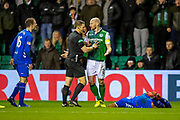 Referee Steven McLean steps between Andy Halliday (#16) of Rangers FC and David Gray (#2) of Hibernian FC, after Gray had fouled Alfredo Morelos (#20) of Rangers FC during the Ladbrokes Scottish Premiership match between Hibernian and Rangers at Easter Road, Edinburgh, Scotland on 8 March 2019.