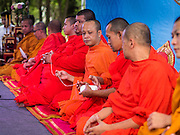 11 AUGUST 2015 - BANGKOK, THAILAND: Buddhist monks start a chanting service to honor Queen Sirikit of Thailand before her 83rd birthday. Queen Sirikit was born Mom Rajawongse Sirikit Kitiyakara on August 12, 1932. She is the queen consort of Bhumibol Adulyadej, King (Rama IX) of Thailand. She met Bhumibol in Paris, where her father was the Thai ambassador. They married in 1950, she was appointed Queen Regent in 1956. The King and Queen had one son and three daughters. She has not made any public appearances since her hospitalization in 2012. Her birthday is celebrated as Mother's Day in Thailand, schools and temples across Thailand hold ceremonies to honor the Queen and mothers.      PHOTO BY JACK KURTZ