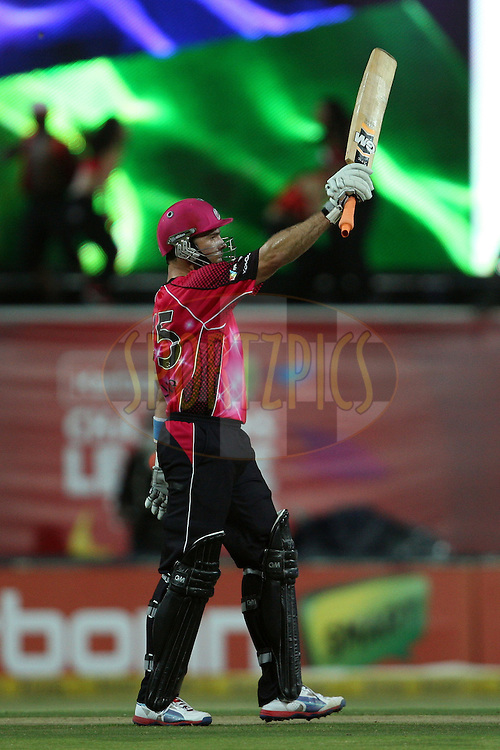 Michael Lumb celebrates his half century during the Final in the Karbonn Smart CLT20 between the Sydney Sixers and the Highveld Lions held at the Wanderers Cricket Stadium, Johannesburg, South Africa on the 27th October 2012. Photo by Jacques Rossouw/SPORTZPICS/CLT20