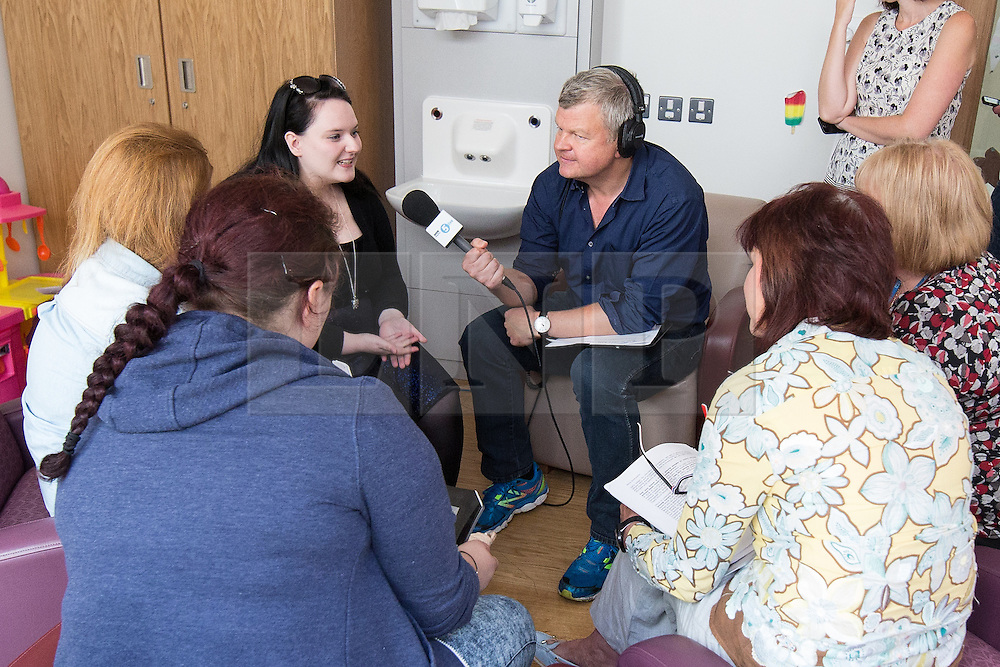 © Licensed to London News Pictures . 11/08/2015 . Merseyside , UK . ADRIAN CHILES (with microphone)interviews young carers in the Family Room at Clock View Hospital . BBC Radio 5 Live broadcast live from Clock View mental health Hospital in Merseyside . Photo credit : Joel Goodman/LNP