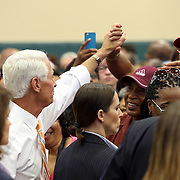 "Charlie Crist shakes hands with supporters after First Lady Michelle Obama appeared at his grassroots ""Commit to Vote"" rally. The campaign called on the event to "" energize voters and lay out the stakes for Floridians in the critical election on November 4th."" at the Barnett Park Gymnasium in Orlando, Florida on Friday, Nov. 17, 2014. (AP Photo/Alex Menendez)"