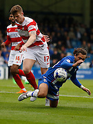 Bradley Dack goes down in the box after a suspected push in the back from Gary MacKenzie during the Sky Bet League 1 match between Gillingham and Doncaster Rovers at the MEMS Priestfield Stadium, Gillingham, England on 5 September 2015. Photo by Andy Walter.