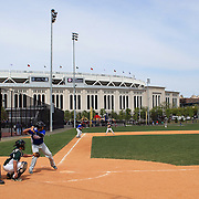 Youngsters playing baseball with the backdrop of Yankee Stadium in the Bronx, New York before the New York Yankees V Detroit Tigers Baseball game at Yankee Stadium, The Bronx, New York. 28th April 2012. Photo Tim Clayton