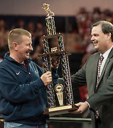 Head coach Tom Westerberg receives the Chevrolet Class 5A Team of the Year trophy from Glen Pirtle during Allen High School's football state championship community celebration at the Allen Event Center on Wednesday, January 30, 2013 in Allen, Texas. (Cooper Neill/The Dallas Morning News)