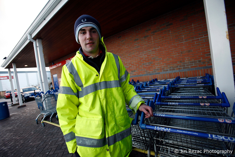 UNITED KINGDOM WALES ANGLESEY 18NOV10 - A Tesco worker named Mark Wilson (22) from Holyhead collects trolleys outside the Tesco supermarket in Holyhead, Anglesey, north Wales where Prince William serves as an RAF Search and Rescue helicopter pilot...Prince William and his fiancee Kate Middleton have been seen shopping at this store...jre/Photo by Jiri Rezac..© Jiri Rezac 2010