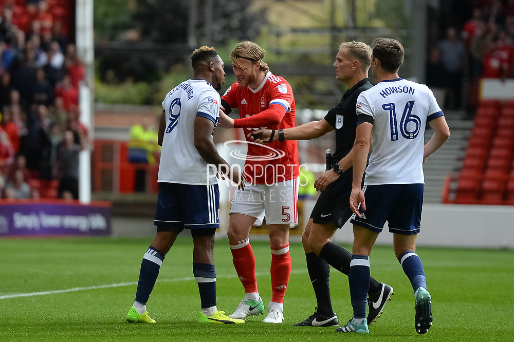 Nottingham Forest defender Matt Mills (5) pushes Middlesbrough forward Britt Assombalonga (9) after fouling Nottingham Forest goalkeeper Jordan Smith (43) during the EFL Sky Bet Championship match between Nottingham Forest and Middlesbrough at the City Ground, Nottingham, England on 19 August 2017. Photo by Jon Hobley.