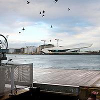 Nederland, Amsterdam , 13 december 2011..Overhoeks aan de andere kant van het IJ gezien vanaf de achterkant van Centraal Station met het nieuwe Eye gebouw..EYE is het nieuwe instituut voor film in Nederland..Foto:Jean-Pierre Jans
