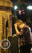 Manchester UK  24.12.2016: Images from Manchesters Gay Village during the Mad Friday celebrations this on the 23 and 24th of December,<br /> <br /> A man looks worse wear and  rest against a telephone cabinet