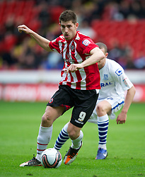 SHEFFIELD, ENGLAND - Saturday, March 17, 2012: Sheffield United's Ched Evans in action against Tranmere Rovers during the Football League One match at Bramall Lane. (Pic by David Rawcliffe/Propaganda)