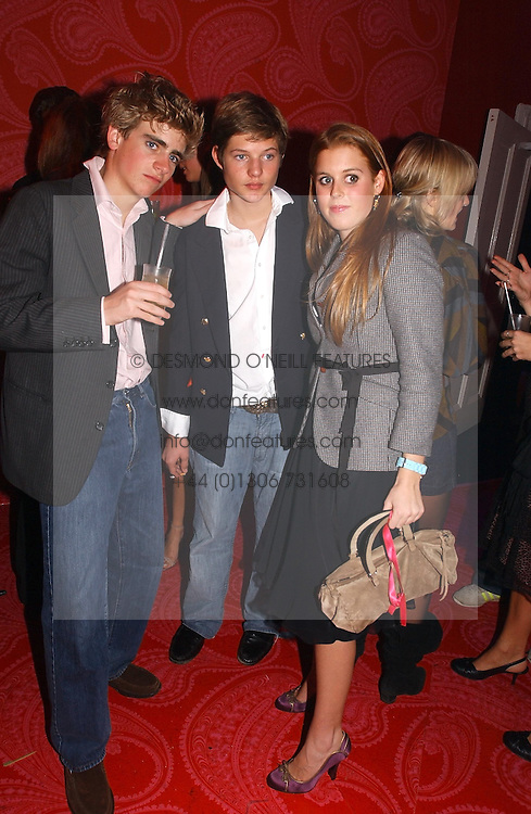 Left to right, FREDDIE RYECART, COUNT NIKOLI VON BISMARCK and PRINCESS BEATRICE OF YORK at a party hosted by jeweller Theo Fennell and Dominique Heriard Dubreuil of Remy Martin fine Champagne Cognac entitles 'Hot Ice' held at 35 Belgrave Square, London, W1 on 26th October 2004.<br /><br />NON EXCLUSIVE - WORLD RIGHTS
