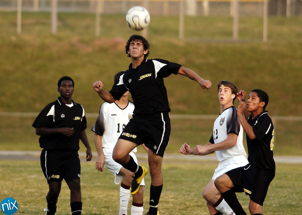 Concord's Steven Criscoe heads the ball against JM Robinson Tuesday night.