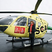 FREE TO USE PHOTOGRAPH....30.10.15<br /> Scotland's Charity Air Ambulance (SCAA) unveiled it's new helicopter at Perth airport this morning a EC135 T2i (pictured) which replaces the Bolkow 105 helicopter which is retiring from service. The new helicopter will increase speed, range, endurance and payload, allow SCAA to fly at night and in cloud. Pictured Helen Page Clydesdale Bank<br /> for further info please contact Maureen Young on 07778 779000<br /> Picture by Graeme Hart.<br /> Copyright Perthshire Picture Agency<br /> Tel: 01738 623350  Mobile: 07990 594431