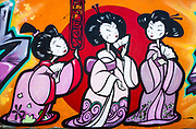 Street art, graffiti, adorns many Christchurch buildings, railway cuttings and public parks, Japanese geisha girls.