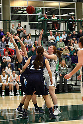 20 February 2016:  Maddie Merritt gets off a shot in the middle of the paint while double teamed during an NCAA women's basketball game between the Elmhurst Bluejays and the Illinois Wesleyan Titans in Shirk Center, Bloomington IL