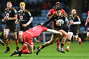 Wasps fly half Jacob Umaga (10) hands off Saracens fullback Alex Goode (15) during the Gallagher Premiership Rugby match between Wasps and Saracens at the Ricoh Arena, Coventry, England on 21 February 2020.