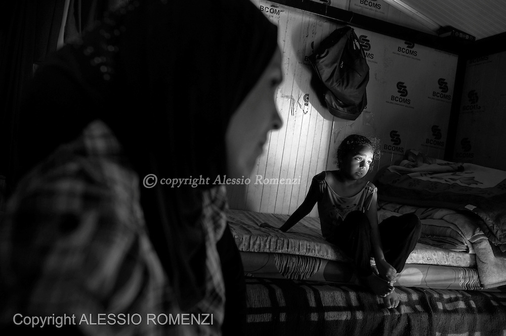 LEBANON: Saida.<br /> Sajida and her daughter are seen inside a prefab house at Albunian Camp in Saida,  where they are now living after they fled the Yarmouk Palestinian refugee camp in Damascus. ALESSIO ROMENZI