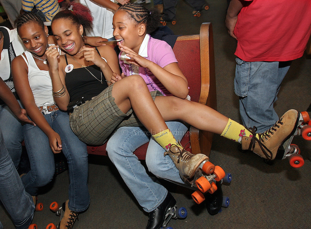 (071107  Boston, MA)  Monyque Dailey, 15, of Dorchester, center, lands on her friend Taishon Skinner, 13, left, and her cousin Shanice Boyd, 11, during the Be Smart program at Chez Vous in Mattapan, Wednesday,  July 11, 2007.    Staff photo by Angela Rowlings.