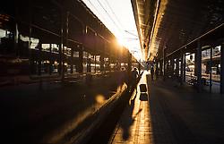 THEMENBILD - Oeffentliches Verkehrsmittel Oesterreichische Bundesbahnen. Das Bild wurde am 11. August 2013 aufgenommen. im Bild Person mit Reisekoffer steigt bei Sonnenaufgang in Waggon ein // THEME IMAGE FEATURE - Public Transport. Austrian Federal Railways. The image was taken on august, 11th, 2013. Picture shows person with luggage boarding railway car at sunrise , AUT, EXPA Pictures © 2013, PhotoCredit: EXPA/ Michael Gruber