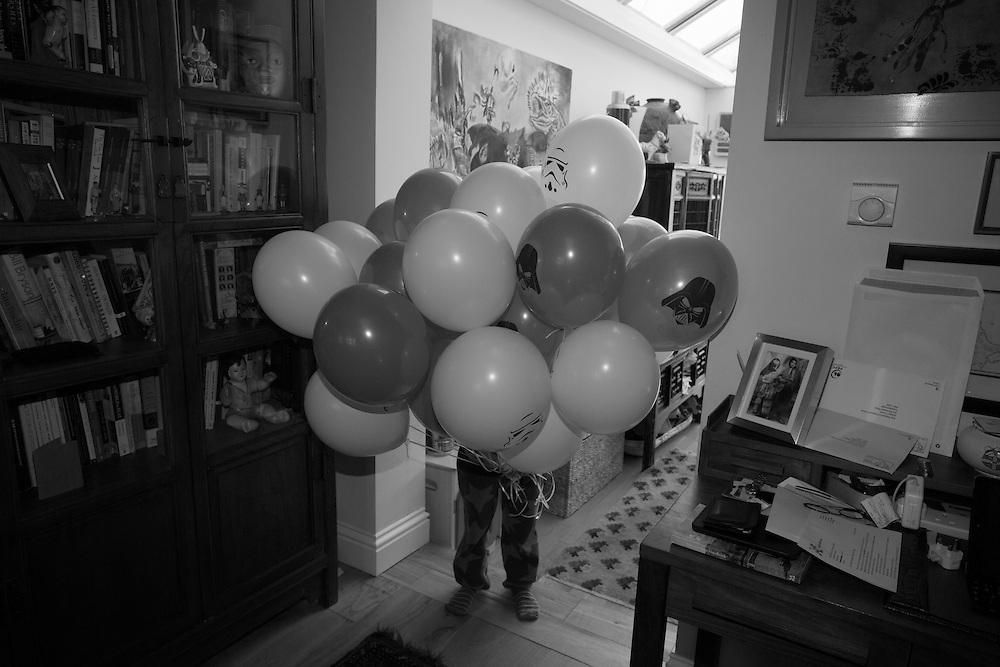 Joe holds balloons for his party at home in Berkhamsted, England  Sunday, March 13, 2016 (Elizabeth Dalziel) #thesecretlifeofmothers #bringinguptheboys #dailylife