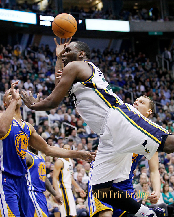 Utah Jazz center Al Jefferson, center, is fouled by Golden State Warriors center Andris Biedrins of Latvia, back, as small forward Richard Jefferson (44) also defends during the second half of an NBA basketball game, Friday, April 6, 2012, in Salt Lake City. Jefferson scored 30-points in Utah's 104-98 win.  (AP Photo/Colin E Braley).