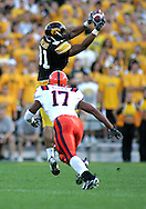 08 SEPTEMBER 2007: Iowa tight end Tony Moeaki (81) catches a pass in front of Syracuse safety A.J. Brown (17) in Iowa's 35-0 win over Syracuse at Kinnick Stadium in Iowa City, Iowa on September 8, 2007.