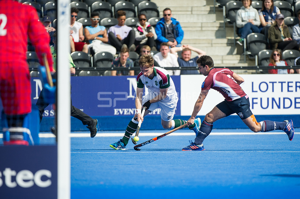 Surbiton's David Goodfield is tackled by Ben Arnold of Wimbledon. Wimbledon v Surbiton - Men's Hockey League Final, Lee Valley Hockey & Tennis Centre, London, UK on 23 April 2017. Photo: Simon Parker