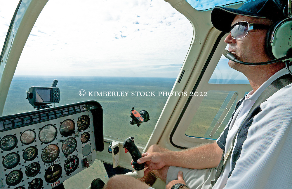 Pilot Tim Moses at the control of a Broome Helicopters Bell Jetranger over Fitzroy Crossing.