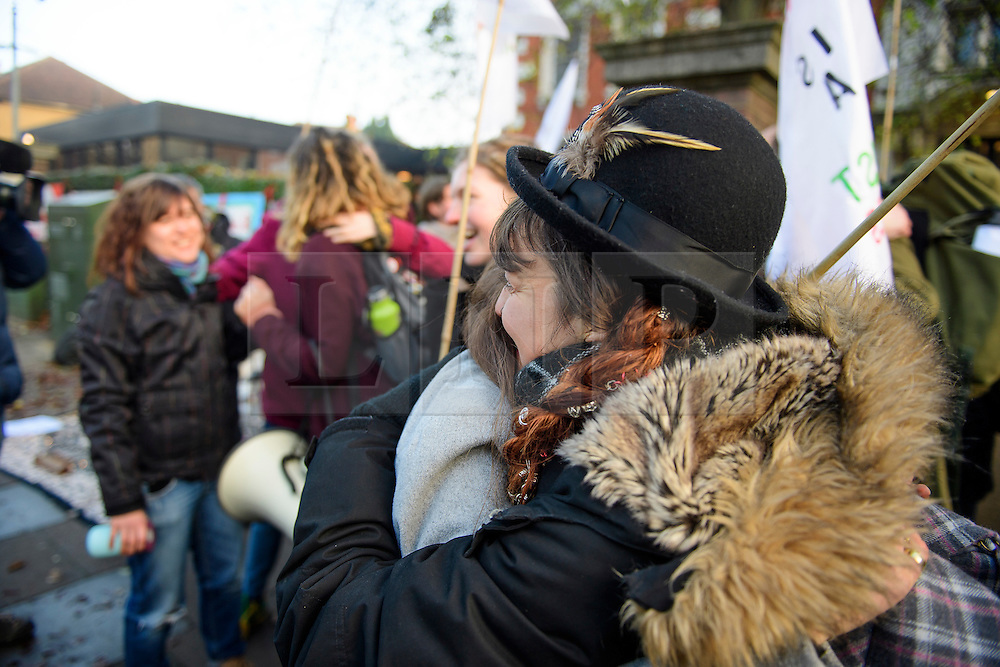 © Licensed to London News Pictures. 22/12/2016. London, UK. Two of the accused protestors embrace as they arrive at Ealing Magistrates Court in London.  protestors are charged with Wilful Obstruction of the Highway after blocking an access road to Heathrow on November 18, 2016. Photo credit: Ben Cawthra/LNP