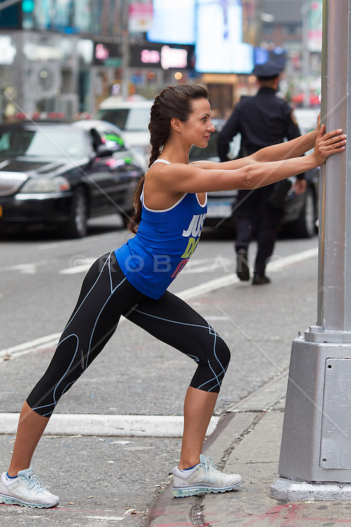 woman stretching on the street in New York City