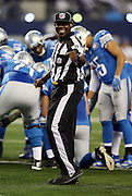 Umpire Roy Ellison (81) has a laugh as he points with his fist between plays during the Dallas Cowboys NFL week 18 NFC Wild Card postseason football game against the Detroit Lions on Sunday, Jan. 4, 2015 in Arlington, Texas. The Cowboys won the game 24-20. ©Paul Anthony Spinelli