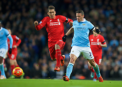 MANCHESTER, ENGLAND - Saturday, November 21, 2015: Liverpool's Roberto Firmino in action against Manchester City's Martin Demichelis during the Premier League match at the City of Manchester Stadium. (Pic by David Rawcliffe/Propaganda)