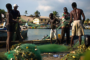 Men and boys sort nets after returning from fishing at sea at the harbor in Elmina, about 130km west of Ghana's capital Accra on Thursday April 9, 2009. Throughout sub-Saharan Africa, losses due to illegal, unregulated or unreported fishing are estimated at US$1 billion, roughly a quarter of Africa's total yearly fisheries exports.