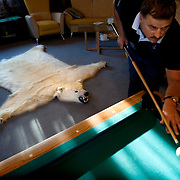 Russian billionaire Sergei Veremeenko at his country home in Moscow, Russia. On the floor is the skin of a polar bear which he said was shot dead by his friend during hunting.