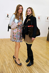 Left to right, JULIA VAN HAGEN and CAMILLA EMSON at the inaugural exhibition at the Yvon Lambert London Gallery featuring work ny Mexican born artist Carlos Amorales, 20 Hoxton Square, London N1 on 16th October 2008.
