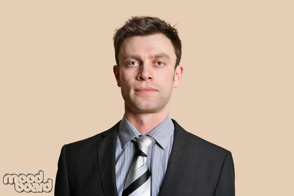 Portrait of a mid adult business professional over colored background