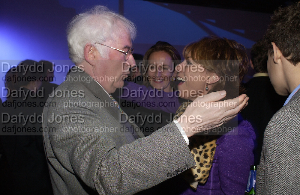 Seamus Heaney and Kathy Lette. The Almeida Theatre Charity Christmas Gala, to raise funds for the theatre, at the Victoria Miro Gallery, London.  1 December  2005. ONE TIME USE ONLY - DO NOT ARCHIVE  © Copyright Photograph by Dafydd Jones 66 Stockwell Park Rd. London SW9 0DA Tel 020 7733 0108 www.dafjones.com