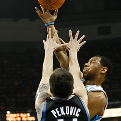February 7, 2011; New Orleans, LA, USA; New Orleans Hornets shooting guard Willie Green (33) shoots over Minnesota Timberwolves center Nikola Pekovic (14) during the first quarter at the New Orleans Arena.   Mandatory Credit: Derick E. Hingle